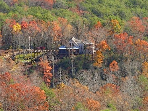 View of our log cabin from top of Big Rock in Pickens