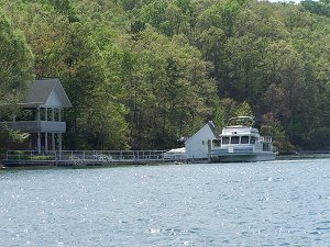 A houseboat on Lake Keowee at her dock